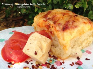 Cheese and tomato topped bread rolls